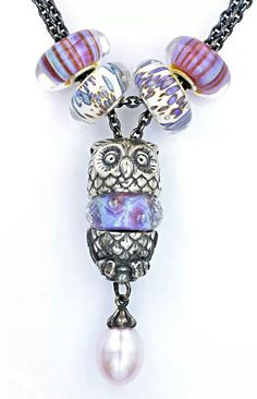 Beautiful, wise owl on a fantasy pearl necklace.