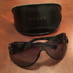 Gucci Sunglasses These Gucci Sunglasses are an oversize rimless metal shield with sleek cut-away lenses. The signature Gucci logo is featured on the hinges. Gucci Accessories Sunglasses