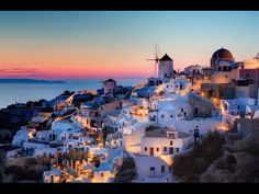 Watch the sun set over the Mediterranean Sea from Santorini, one of the most beautiful Greek Islands.Santorini is an island in the southern Aegean Sea, about 200 km mi) southeast of Greece's mainland. Places In Europe, Places Around The World, Places To Travel, Places To See, Travel Destinations, Travel Tourism, Romantic Destinations, Romantic Getaways, Holiday Destinations