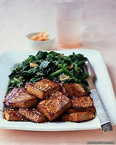 Tofu takes on the flavors of its marinade: soy sauce, sesame oil, chili paste, lime juice, ginger, and garlic. It is cooked and served with sauteed, calcium-dense greens.