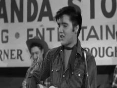 Click on GIF to make Elvis move! Elvis sings and dances on stage