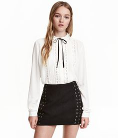 White. Blouse in crêped viscose fabric with lace inserts and pin-tucks at front. Small Peter Pan collar with attached tie and long sleeves with button at