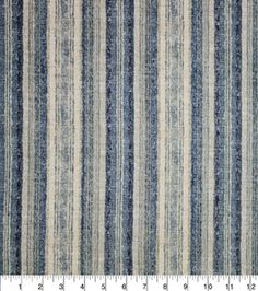 A  textural stripe with an ombre effect is a great decorative layering element. The natural and indigo colors reinforce the subtle striping. This is a foundational pattern in the Home Essentials colle