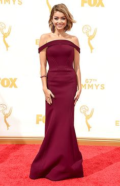 Sarah Hyland in an oxblood Zac Posen dress with a peekaboo back at the 2015 Emmy Awards.  Read more: http://www.usmagazine.com/celebrity-style/pictures/emmy-awards-2015-red-carpet-fashion-2015189/47246#ixzz3maIQlrwP  Follow us: @usweekly on Twitter | usweekly on Facebook