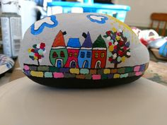 Whimsical houses painted rock