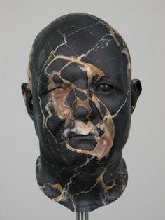 "brute old-school polychrome helmet-head Apollo (Bill Jensen)  2000 - 2004  Italian ""Portoro"" marble"