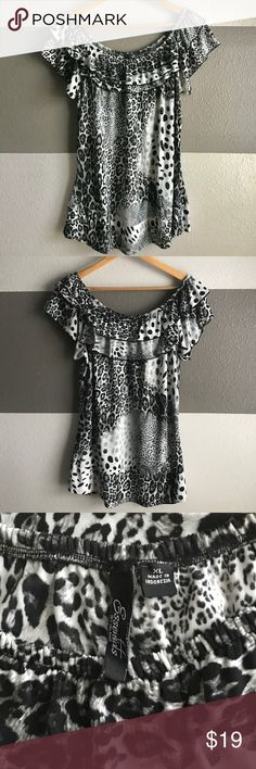 Essentials By Milano Show off your wild side with with top. It is perfect for dress pants or jeans for the night out. This top is in great condition with material that forms to any body type. Essentials by Milano Tops Blouses
