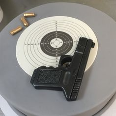 Target Practice Birthday Cake with Fondant Gun and Bullets