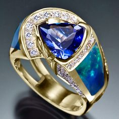 Pave diamonds surround a 2 ct. Tanzanite and the Ethiopian Opal inlays on both sides
