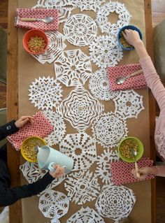 Set the table with a paper snowflake runner.