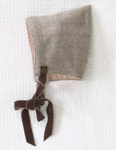 baby bonnet sewing inspiration. love the velvet ribbon ties. by: Olive's Friend Pop