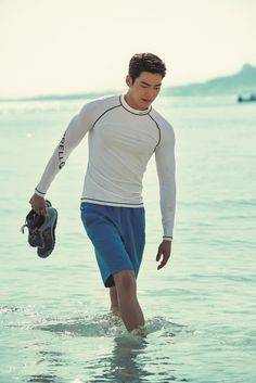 "Model-turned-actor Kim Woo-bin showed off his physique in a recent photo shoot with the global travel magazine ""The Traveler."" Donning a set of rash guards from Murrell, Kim posed in front of the emerald blue waters of Okinawa Island, Japan. Lee Min Ho, Shin Min Ah Kim Woo Bin, Kim Wo Bin, Korean Star, Korean Men, Korean Actors, Korean People, Korean Wave, Asian Actors"