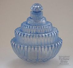 "Ambroise                     Type:Perfume bottle                    Material(s):Glass with light blue patina                    Designer/Maker:Rene Lalique for Rene Lalique et Cie.                    Markings:Etched in script ""R. Lalique France No. 523""                    Origin:France                    Date or Era:Introduced 1928"
