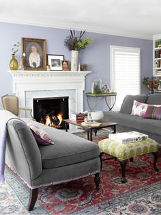 armless velvet sofas, lilac walls, grosgrain ribbon and nailhead trim. Country Living.