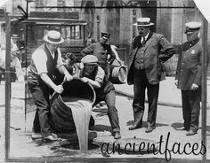 "New York City Deputy Police Commissioner, John A. Leach, watching over agents pouring alcohol into the sewers shortly after a successful prohibition raid in 1921. This was one of the many wins for these agents during prohibition's reign from 1920 through 1933. Of course, prohibition would also help propel the careers of such famous gangsters as Al Capone and ""Bugs"" Moran. Original post: http://www.ancientfaces.com/research/photo/975739/new-york-city-deputy-police-commissioner-john-a-le"