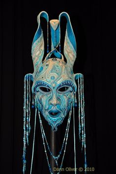 Gwynn Popovac - makes intricately beaded masks that are gorgeous.  Her website doesn't allow for pinning images, but I found this one with a google image search