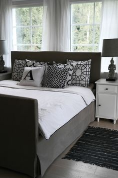 Master bedroom in black white and greige