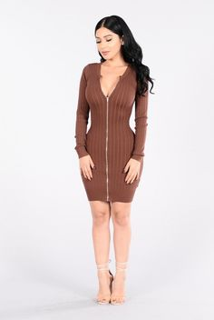 - Available in Red Brown - Boat Neckline - Long Sleeve - Zip Up - Fitted - 70% Rayon, 30% Nylon