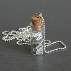 Type Necklace by my dear friend, Laura Tarrish (Portland artist). She will fill this tiny bottle with up to 50 letters of your choice. Cute.