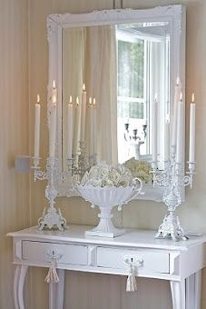 I would add some color to this.. my style would have gold tones.. gold mirror, pink peonies, and gold candelabras