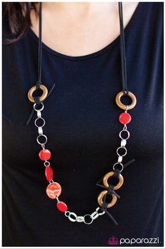 Tied Me Over - Red Item #: P2WH-RDBN-001DH Red discs in a gorgeous shell-finish combine with silver spirals and wooden rings on a black layered suede piece. Features an adjustable clasp closure.  Sold as one individual necklace. Includes one pair of matching earrings.