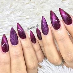 http://www.revelist.com/nails/cat-eye-nail-art/11994/ These berry-colored cat-eye nails totally slay. /8/#/8