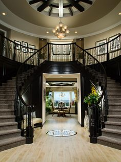 Toll Brothers An elegant dual circular staircase at the foyer greets family and friends. Can I please have this in my future house? Double Staircase, Grand Staircase, Black Staircase, Staircase Design, Home Goods Decor, Home Decor, Foyer Decorating, House Goals, My Dream Home