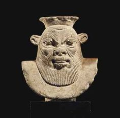 AN EGYPTIAN LIMESTONE BUST OF BES  LATE PERIOD TO PTOLEMAIC PERIOD, 664-30 B.C.