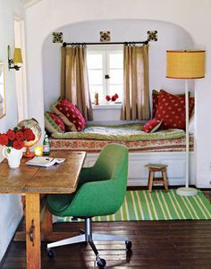 In one of the guest rooms, a vintage French chair with its original fabric is paired with a green-and-white-striped rug by Kathryn M. Ireland for Elson & Company.    - HouseBeautiful.com
