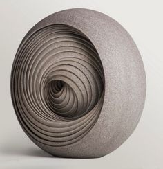 Ensphere II by Matthew Chambers    (This is one of several magnificent works of art in ceramic that illustrate spirals or swirls).