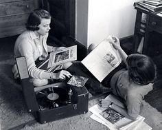 Two young women playing records