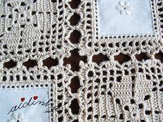 Foto da união dos quadrados do naperon de crochet e linho