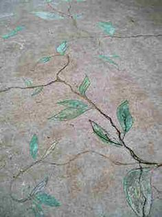 Incredible! A talented woman turned this cracked concrete porch into art.