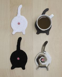 For the rare cat person who doesn't already see more than enough cat butt on a daily basis...  Crocheted coasters, complete with that delicate whorl of pink...