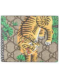 Shop Gucci GG Bengal print billfold wallet.