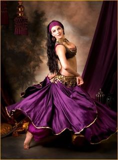 Belly dancer. Love the gold around the bottom of the skirt, jw.