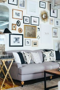 Neutral living room and wall gallery in black, white, grey and gold
