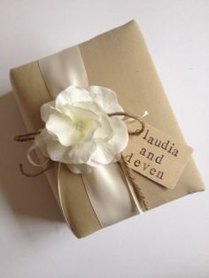 Personalized Wedding Album - Tea Dyed Muslin, White Hydrangeas, Ivory Ribbon, Rustic Ivory Ribbon and Rope Bow, Hand Stamped Wood Tag with Bride and Groom's Names - by CoutureLife