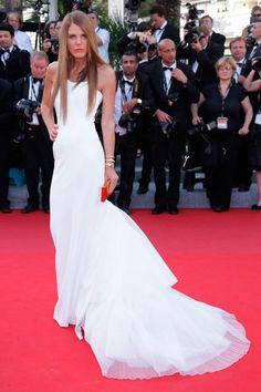 Italian fashionista Anna Dello Russo swept onto the 2012 Cannes red carpet at last night's big premiere in a striking white strapless gown by Alberta Ferretti.