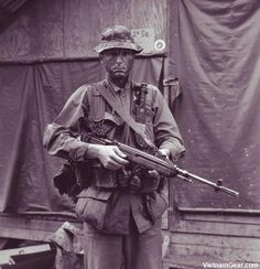 Marine photographer Sgt. David Weimer prepares to go into the field with Co. 'A', Reconnaissance Bn. He has a Ka-Bar knife taped to his M1956 Suspenders and carries an M14 rifle. - Photo taken: April 1967, The National Archives ~ Vietnam War