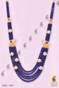 Blue Sapphire Beads Haaram with flowers placed on the beads lines and elephant side motifs on both sides of the neckpiece.Multi strand s beads lines are adorned with beautiful Kundan studded flowers. Beaded Jewelry Designs, Gold Jewellery Design, Bead Jewellery, Jewelery, Jewellery Making, Necklace Designs, Gold Jewelry Simple, Mom Jewelry, Bridal Jewelry