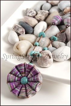 Paper bead flower necklace. I love this design. I made a hundred of them in many colors.