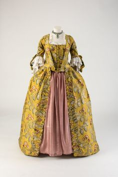 Robe à la francaise, 18th century. Yellow silk brocade, woven with a pattern of…