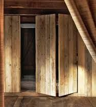 Image result for wardrobes that look like a wooden clad wall
