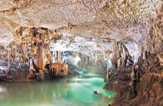 Take me back -- Jeita Grotto, Lebanon. The water is 7 meters deep, and so clean you can drink from it.