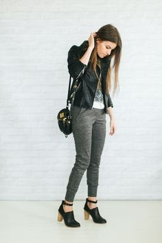 Graphic tee, gray joggers, moto jacket, black ankle boots
