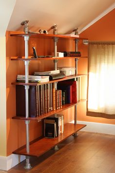 Pole Mounted Floating Bookshelf by Simplified Building Concepts, via Flickr
