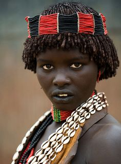 Young African woman from Ethiopia with short dreadlocks. She has an ...