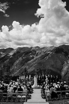 I don't need black and white but I love the far back view of everyone watching us getting married with the mountains in the background. this would look great! - NT