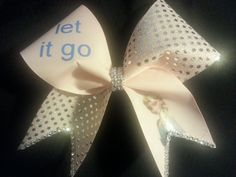 Check out this item in my Etsy shop https://www.etsy.com/listing/197791348/elsa-let-it-go-cheer-bow-silver-glitter